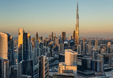 Rooftop view of Dubai's business bay towers at sunset. Famous Dubai's landmark. Stock Images
