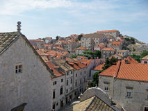 Rooftop view of Dubrovnik Croatia. Rooftop view of limestone houses, church and fort in Dubrovnik Croatia Stock Photography