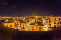 Rooftop view at night on harbor from Catedral de Santa Maria. IBIZA, SPAIN - OCTOBER 10, 2014: Rooftop view at night on harbor from Catedral de Santa Maria stock images