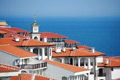 Rooftop view over to black sea. View of rooftop showing clock and gold roof of church looking over the black sea from Bulgaria towards turkey in svetti vlas Stock Image