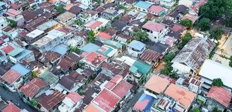 A rooftop view of the shanty town of Cebu City Philippines. A rooftop view looking down across the tops of Cebu City Philippines stock images