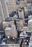 Rooftop Water Tanks NYC. Lower midtown New York City rooftops as viewed from a skyscraper.  This view includes buildings from 36-40th streets Royalty Free Stock Images