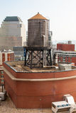 Rooftop Water Tower on NYC Buildings Royalty Free Stock Photo