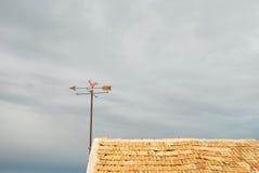 Rooftop weather vane Royalty Free Stock Photo