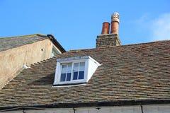 Rooftop window Stock Images