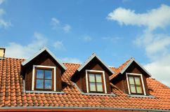 Rooftop with windows against blue sky Stock Image