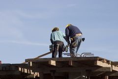 Rooftop Workers royalty free stock images