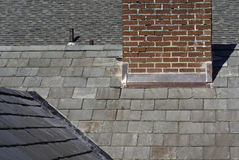 Rooftops. A group of different types of rooftops and a chimneys Stock Photo