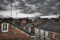 Rooftops. Terraced house rooftops and a factory on a grey overcast cloudy day Stock Image