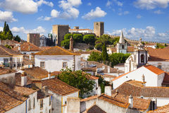 Rooftops and castle of Obidos Stock Images