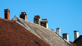 Rooftops and chimneys - Blue sky Stock Photography