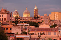 Rooftops and church domes in Rome Italy Royalty Free Stock Photos