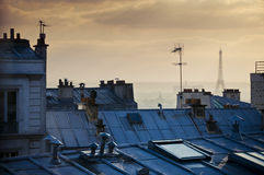 Rooftops and Eiffel Tower. Rooftops at sunset and skyline with Eiffel Tower in Paris, France Stock Photos