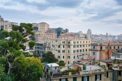Rooftops of Genoa. View over the intimate life happening on the rooftops in the center of Genoa, Italy, and into the distance with the city vista and its many Stock Photos