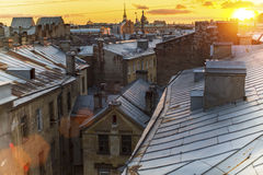 Rooftops historic center St. Petersburg during amazing sunset. Walking. Stock Photos