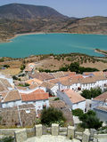 Zahara de la Sierra, Spain. Landscape with rooftops in Zahara de la Sierra, Andalusia, Spain and view to the lake of Embalse de Zahara el Gastor stock photo