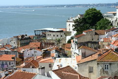 Rooftops of Lisbon. With river view Royalty Free Stock Image