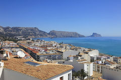 Rooftops and Mediterranean Sea Altea Spain. Mountains and rooftops overlook the Beautiful blue Mediterranean Sea at Altea Spain Royalty Free Stock Photography