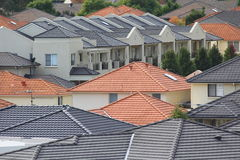 Rooftops of modern homes. Roofs of many modern terraced houses in a district of Sydney (Australia) - contemporary living Stock Image