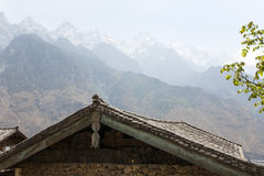 Rooftops and Mountain Peaks Stock Photography