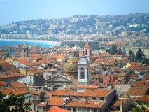 Rooftops in Nice, France. Building details including shutters and balconies of buildings in Nice, France. Red tiled roofs and tower blocks in the distance Royalty Free Stock Image