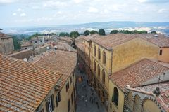 Rooftops of the old town of Volterra with street from above Stock Photos