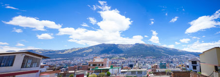 Rooftops with Pichincha volcano in the background Stock Images