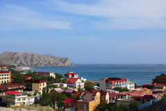 Rooftops of the Seaside town Sudak. Ships in the harbor.Crimea.Sudak Royalty Free Stock Photo