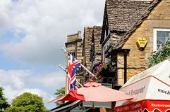Rooftops and Union Jack, Bourton on the Water. Stock Image