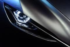 Roofzuchtige autokoplamp Royalty-vrije Stock Afbeelding