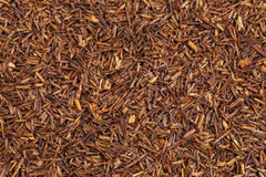 Rooibos red tea. Background texture of rooibos tea, made from the South African red bush, naturally caffeine free Royalty Free Stock Images