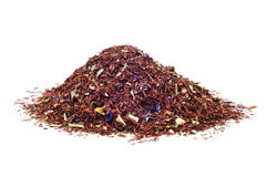 Rooibos tea. A pile of rooibos tea on a white background Royalty Free Stock Photo