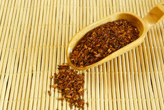 Rooibos tea. Traditional south-african rooibos tea on wooden spoon Stock Images