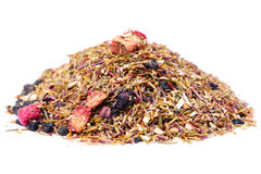 Rooibos tea with berries. Isolated on the white background, selective focus Royalty Free Stock Images