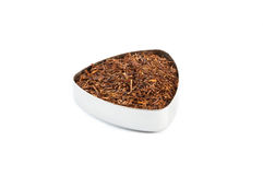 Rooibos tea. Bio rooibos classic tea in a metal container Stock Images