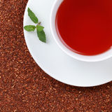 Rooibos Tea in a cup. With copy space, served with a balm Royalty Free Stock Images