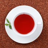 Rooibos Tea in a cup. Decorated with a mint Royalty Free Stock Photography