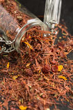 Rooibos tea. With fruits and flowers Royalty Free Stock Image