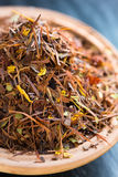 Rooibos tea. With fruits and flowers in a bowl Royalty Free Stock Photography