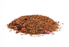 Rooibos tea. A mound of rooibos tea infused with strawberry flavor Royalty Free Stock Photo