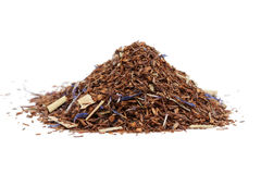 Rooibos tea. A pile of rooibos tea on white background Stock Photos