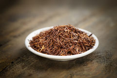 Rooibos tea on a small plate Stock Image