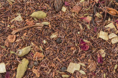 Rooibos tea. With spices: cinnamon and cardamom, fennel, anise star, roses, apple, cloves Stock Photo