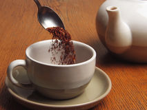 Rooibos tea, still life. Pouring rooibos tea (red bush). Still life Stock Images