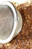 Rooibos tea with tea strainer Stock Photo