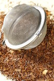 Rooibos tea with tea strainer Stock Images