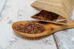 Rooibos tea. Traditional south-African rooibos tea on wooden spoon Royalty Free Stock Photos