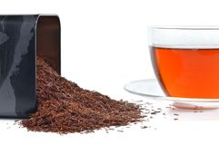 Rooibos in a tin and cup. Royalty Free Stock Photo
