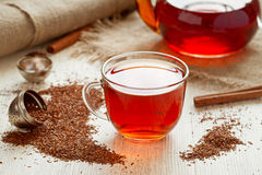 Rooibus tea traditional south africa antioxidant. Healthy rooibus tea traditional south africa antioxidant beverage with spices on vintage wooden table in rustic Stock Images