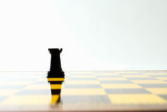 Rook. The reflection of a rook on the chessboard Royalty Free Stock Photos